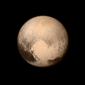"Image from the Long Range Reconnaissance Imager (LORRI) aboard NASA's New Horizons spacecraft, taken on 13 July 2015. Pluto is dominated by the feature informally named the ""Heart."" (Image Credit: NASA/APL/SwRI)"