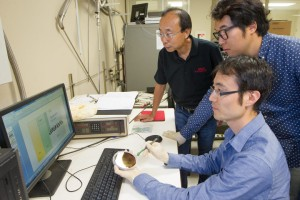 Stanford electrical engineering professor H.-S. Philip Wong, left, graduate student Joon Sohn and postdoctoral fellow Seunghyun Lee (seated) are developing high-capacity, energy-efficient memory chips that are not based on silicon. (Photo: Norbert von der Groeben)