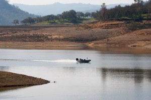 A fishing boat motors across Lake Nacimiento in San Luis Obispo County on Tuesday, January 26, 2016.  The recent rains have raised the water level to 22% of capacity.  (Vern Fisher - Monterey Herald)