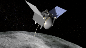 An artist's concept of the OSIRIS-REx spacecraft preparing to take a sample from the near-Earth asteroid called Bennu. The mission is scheduled for launch this September. (Credit: NASA)