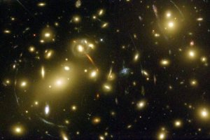 "A Hubble Space Telescope image of galaxy cluster Abell 2218 showing ""strong"" gravitational lensing. (Credit: NASA, A. Fruchter and the ERO Team)"